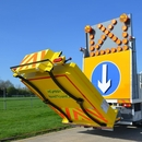 Truck mounted attenuator with arrow board expanding